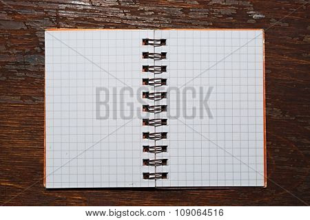 Notebook with square grid on a table