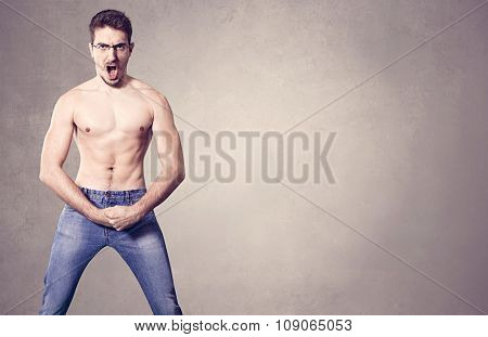 nerd with muscles on grey background