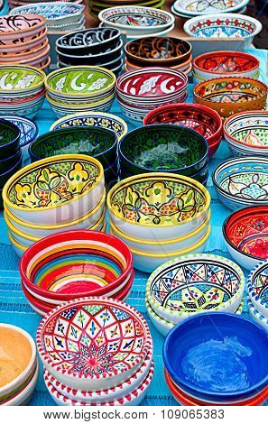 Colorful bowls with ornament, vertical