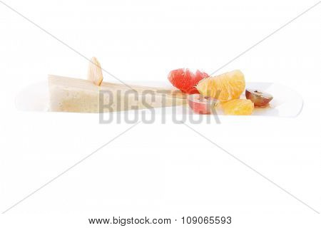 clean raw fruits and cream cake on white