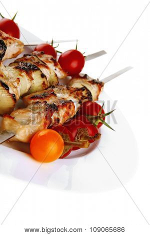 fresh turkey barbecue shish kebab served with tomatoes capers on platter isolated over white background