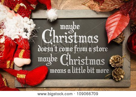 Blackboard with the text: Maybe Christmas Doesn't Come From a Store, Maybe Christmas Means a Little Bit More