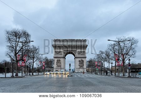 PARIS, FRANCE - CIRCA MARCH 2010: Quiet early Sunday morning on the Champs-Elysées and the Arc de Triomphe.