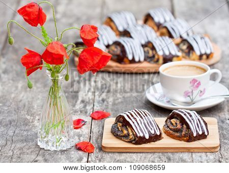 Cup Of Coffee With Poppy Buns Glazed With Chocolate And Poppy Flowers