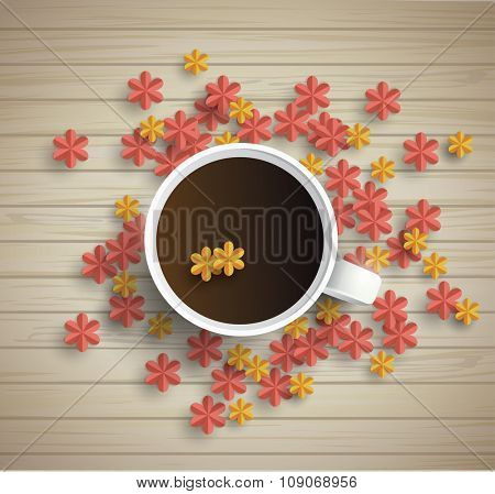 Wooden background with Cup of coffee and paper flowers
