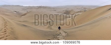 Walking Alone In The Huacachina Desert, Peru