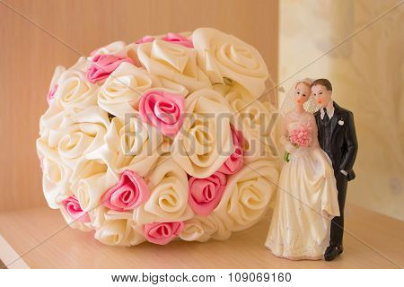 Wedding bouquet and figurine