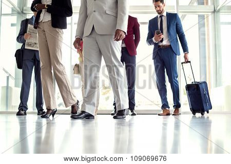 Close up of businessmen at airport