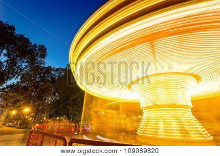 Fast merry-go-round lighting in the night