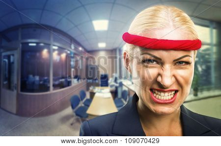 Furious businesswoman with a red bandage in the office