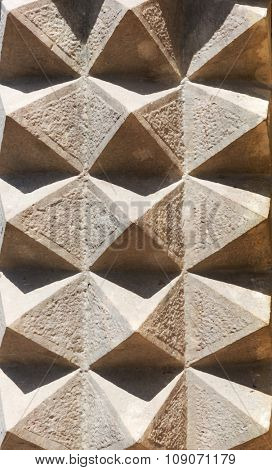 Mosaic pattern of stucco on the wall