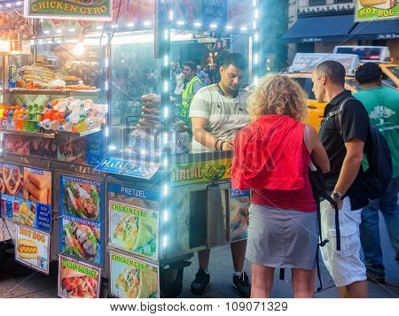 NEW YORK,USA - AUGUST 14,2015 : Fast food cart at 5th Avenue in New York City at night