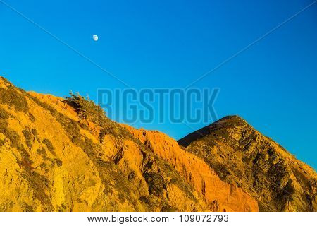 Moon Above Rocks At Pfeiffer State Park, Big Sur, California