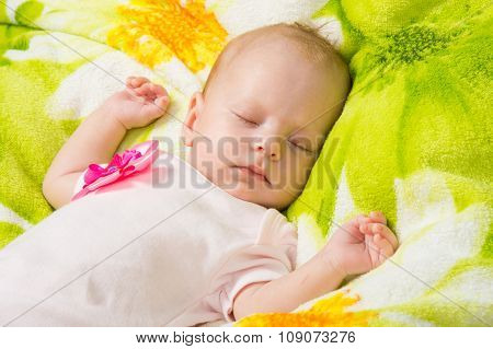 The Two-month Baby Carefree Sleeping On A Soft Bed
