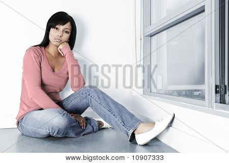 Depressed Woman Sitting On Floor