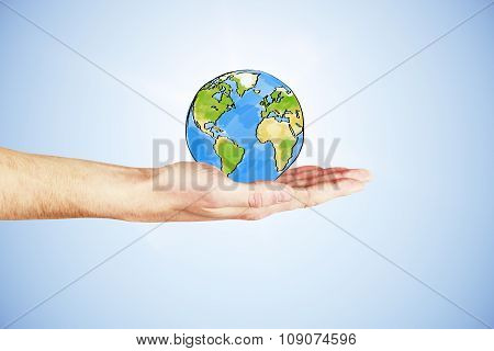 The Whole World In Your Hand Concept With Hand And Drawn Earth Planet