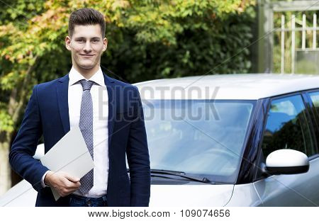 beautiful young insurance agent watching straight in camera