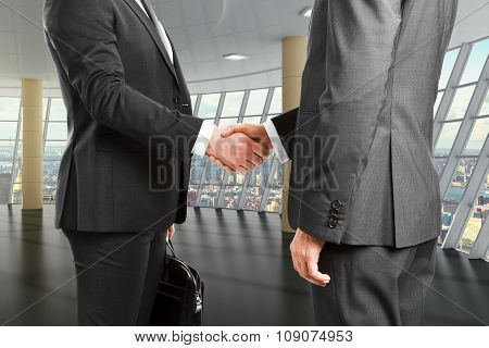 Business Partners Shake Hands In Empty Room