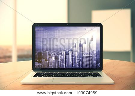 Laptop Screen With Double Explosure City And Business Graph On Wooden Table