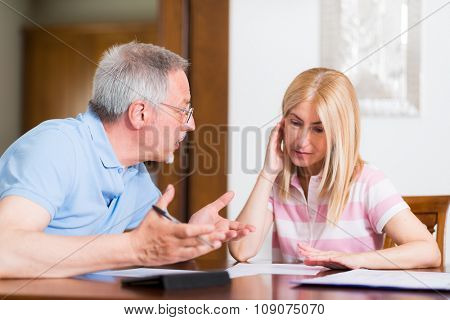Couple calculating their expenses together