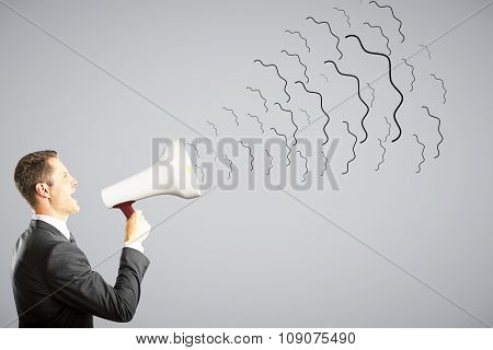 Businessman Shouts Through Megaphone