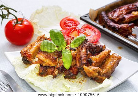 Grilled pork ribs served on a platter. Step on step recipe.
