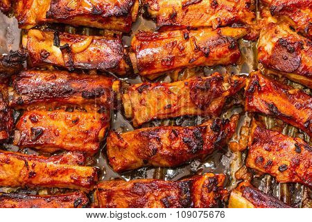 Grilled pork ribs on a baking sheet. Step on step recipe.