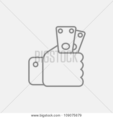 Hand holding money line icon for web, mobile and infographics. Vector dark grey icon isolated on light grey background.
