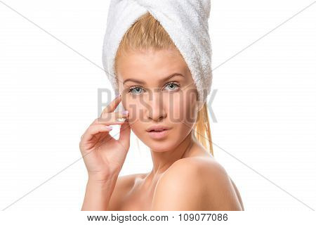 Young attractive blond woman with blue eyes in a towel