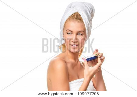 Beautiful spa girl holding jar of cream isolated on white