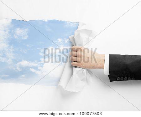 Hand Turns White Paper