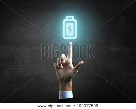 beautiful Business male hand indicating battery icon