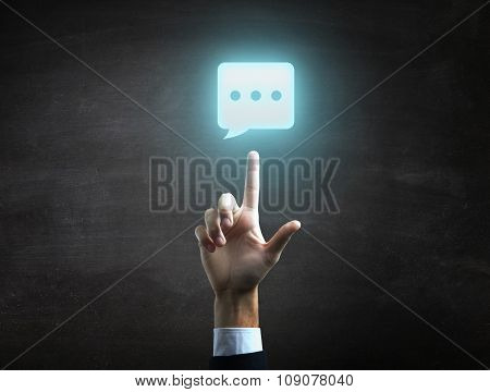 beautiful Business male hand indicating chat icon