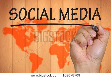 Hand Writing Social Media Over Blur World Background