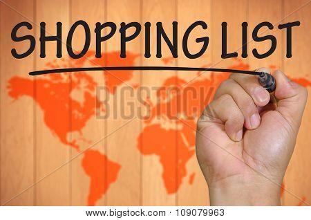 Hand Writing Shopping List Over Blur World Background