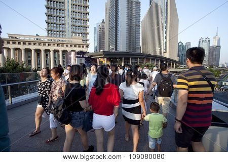 SHANGHAI, CHINA, 25 JULY, 2015:Visitors in Shanghai. Tourists in the Shanghai Lujiazui financial and Trade Zone at 25 July, 2015