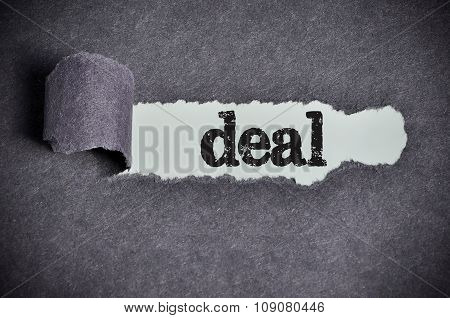 Deal Word Under Torn Black Sugar Paper