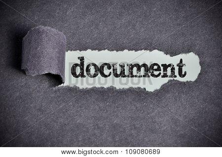 Document Word Under Torn Black Sugar Paper