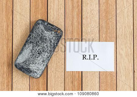 Top View Broken Of Smart Phone And Blank Paper On Wooden Table