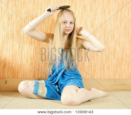 Girl Combing Her Long Hair