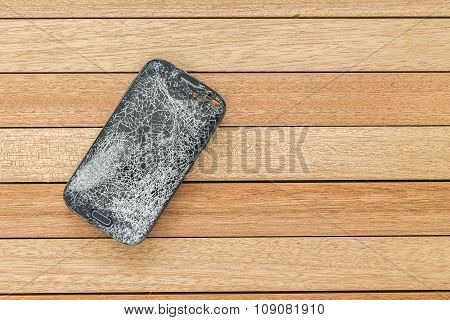 Top View Broken Of Smart Phone On Wooden Table