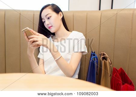Girl Sitting In Coffee Shop