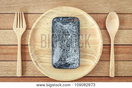 Broken Smartphone On Wooden Dish On Wooden Plank Background