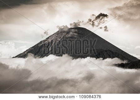 Ash cloud rising at Semeru Volcano Mountain, East Java, Indonesia. Black and white dramatic photo