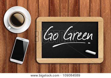 Coffee, Phone  And Chalkboard With  Word Go Green
