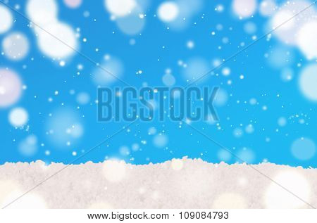 white snow against blue decorative christmas background