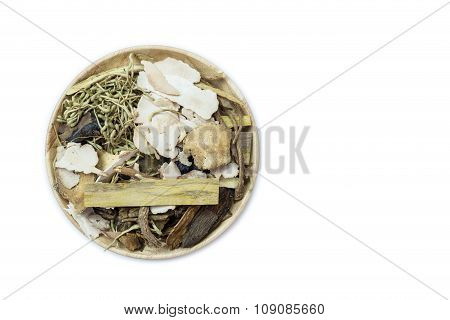 Mix Of Chinese Herbal Medicine In Wooden Dish Isolated On White