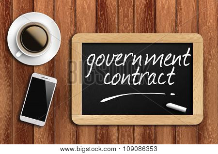 Coffee, Phone  And Chalkboard With Word Government Contract