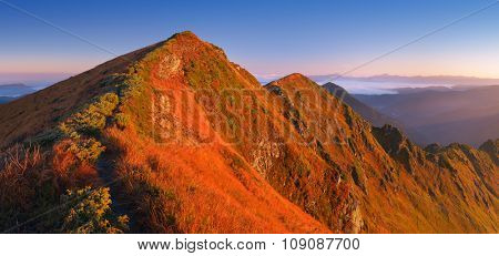 Panorama from the ridge. Path to the top of mountain. Sunny morning. Carpathians, Ukraine, Europe
