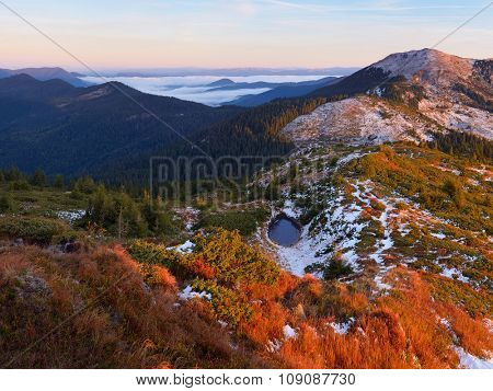 Mountain Lake. Autumn landscape. Sunny morning in the mountains. Carpathians, Ukraine, Europe